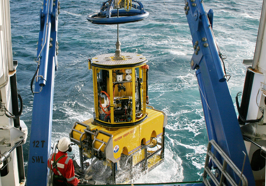 ROV being lifted on to the back of a boat